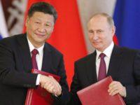 Владимир Путин поздравил Си Цзиньпина с новым сроком на посту главы КНР